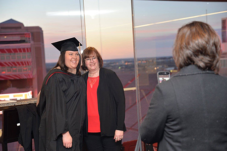 Kristen Harvey, an MPA graduate from Lincoln, Nebraska, celebrates at East Memorial Stadium Club.