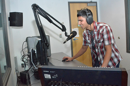 Fernando DJing at the College of Journalism and Mass Communication.