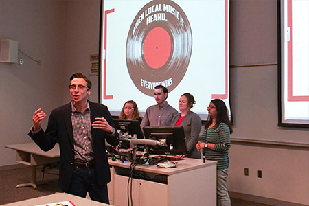 AuthentiCity team members present their business idea to help local musicians grow and showcase their music at a series of concerts