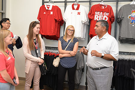 Rik Barrera, associate dean of student services and chief operating officer at the College of Business, talks about the Huskers Shop to students.