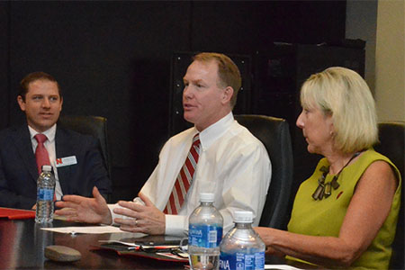 Shawn Eichorst (center) worked with Donde Plowman (right) to create partnerships between athletics and business to build student opportunities.