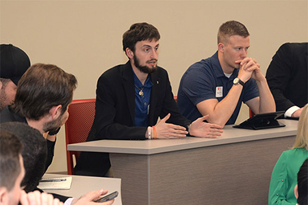 Eric Karl II, a senior accounting major from Southlake, Texas, asks panelists a question during the Executive Insights session.