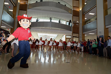 Herbie Husker joined many Nebraska cheerleaders to get the party started at the new Howard L. Hawks Hall.