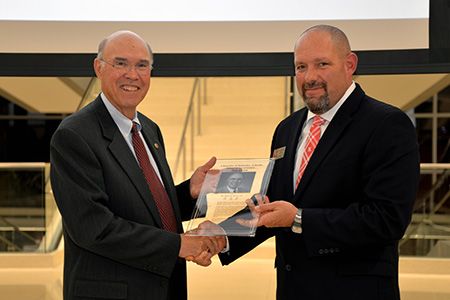 Dr. James Brown (left) receives award from Dr. Aaron Crabtree