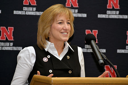 Interim Dean Kathy Farrell speaking at the College of Business.