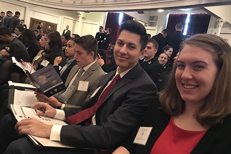 From left: Jess Nguyen, David Petersen, Conrad Shiu and Libby Schwemmer prepare to hear a session at the U.S. Naval Academy Leadership Conference.