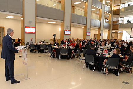 Tonn Ostergard addresses Partnership Summit audience at luncheon in the Henrickson Family Atrium