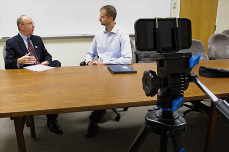 Steven Welton utilizes video production in the classroom, interviewing Nebraska MBA alum Brent Claassen.
