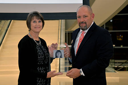 Sue Wilkinson (left) receives award from Dr. Aaron Crabtree