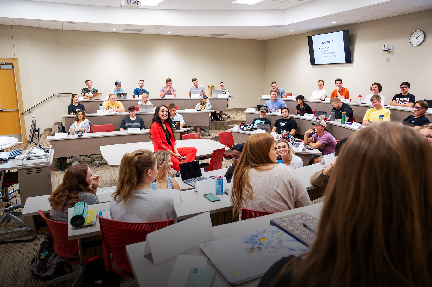Pinar Runnalls talking to her students in the classroom