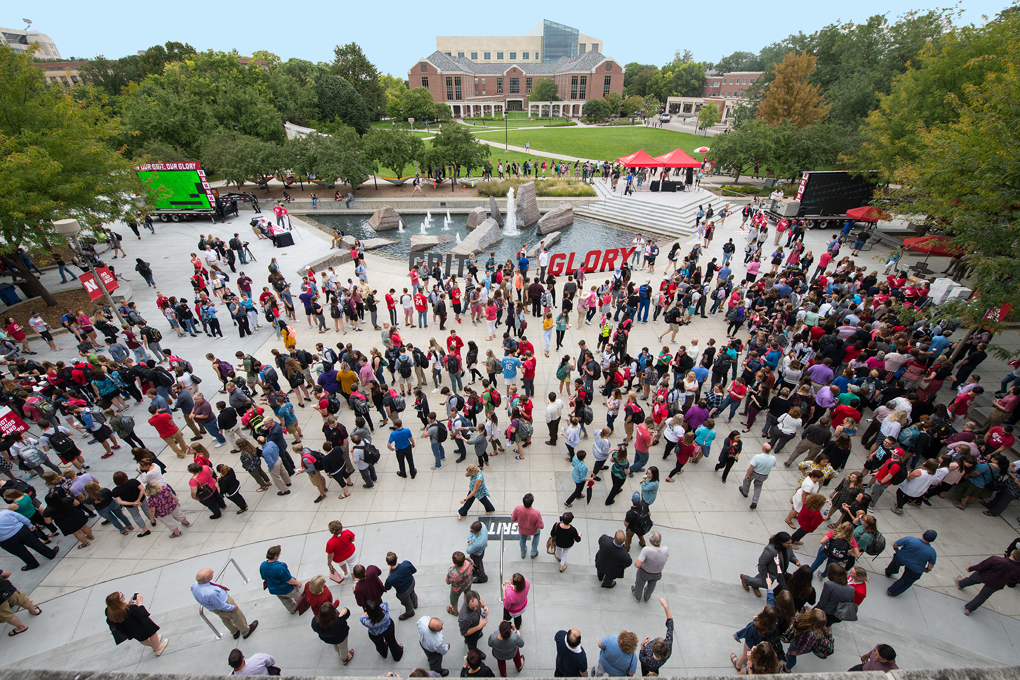 aerial view of students walking past Broyhill Fountain in the plaza north of the Nebraska Union