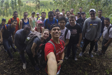Quincey Bernard (center) with fellow students at a teak farm in Panama.