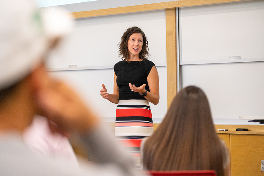 Dr. Kasey Linde teaching in front of a classroom of students.