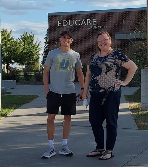 Jordan Kelber and Jayna Ghose helping volunteer at Educare.