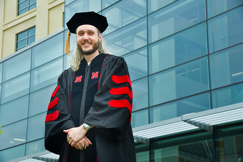 Hanna joins other graduate students for commencement at Pinnacle Bank Arena on May 7