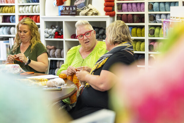 Knitters work at their hobby at a Lincoln yarn shop Knit Paper Scissors.
