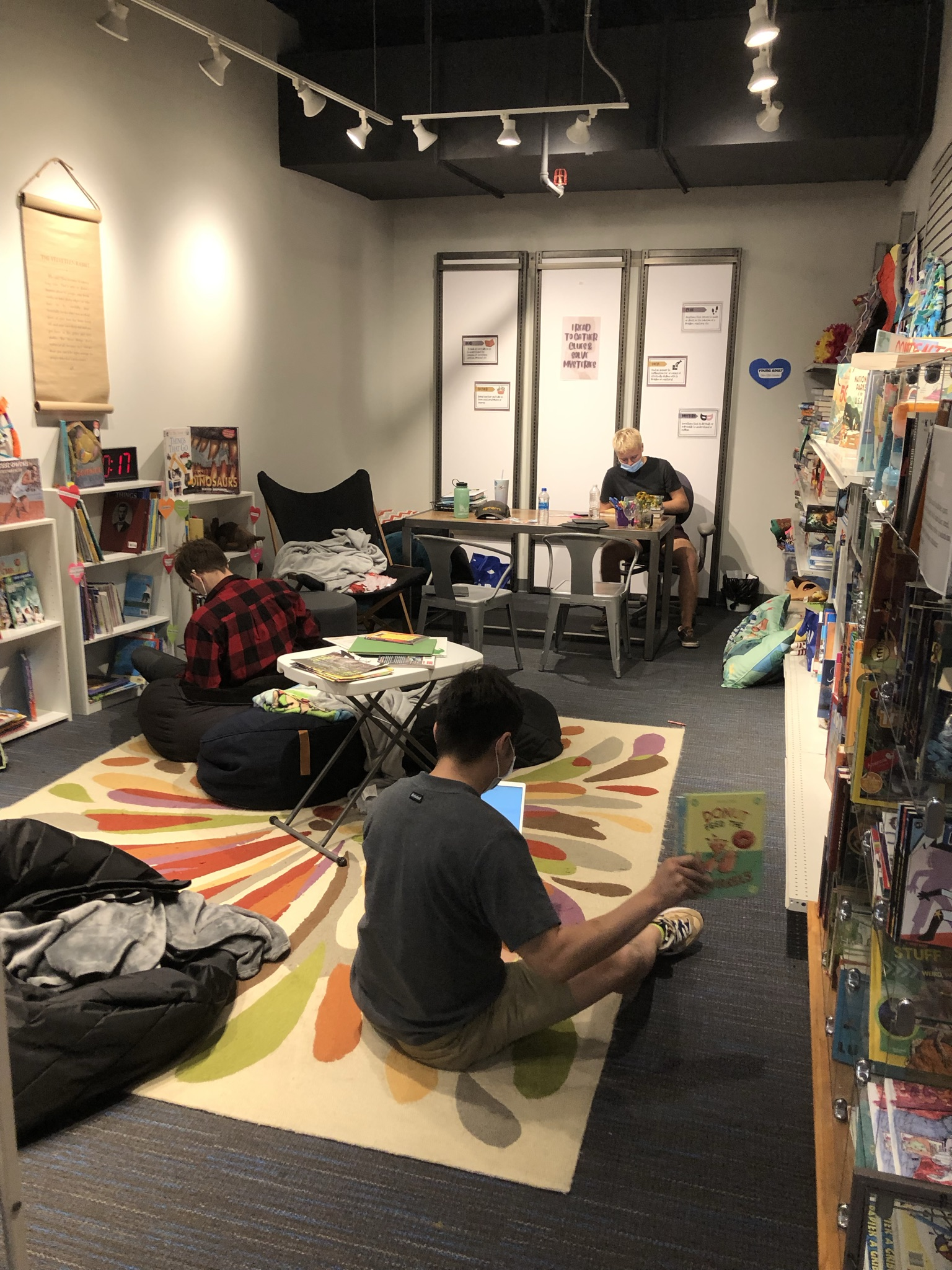 Volunteers helped to inventory hundreds of books in the City Impact library.