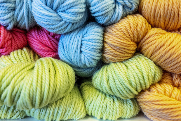 Hanks of yarn displayed at Lincoln yarn shop Knit Paper Scissors.
