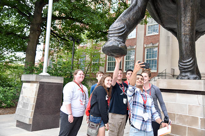 Fares Afshoonkar, '18 and '19, takes a selfie with Accounting Summit students during a scavenger hunt around campus.