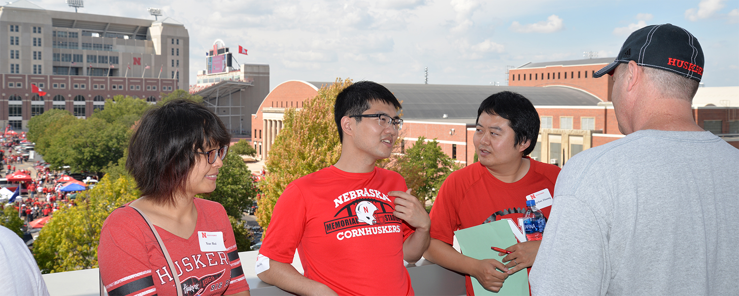 Actuarial Science program guests hang out on the Dean's Terrace before the Husker football contest.