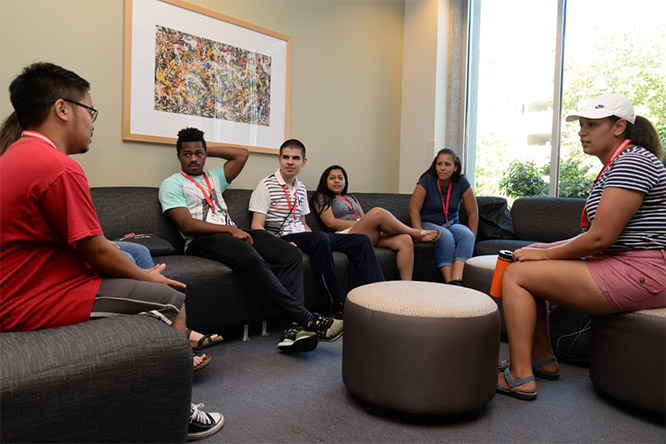 Capell (far right) talks over college life to students at the DREAMBIG Academy, a summer program that provides diverse, upcoming high school seniors the opportunity to learn about the dynamic world of business and potential career opportunities at the College of Business.