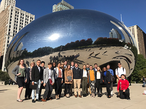 The 19 Nebraska Business students who went on the expedition took a moment to admire Cloud Gate at Millennium Park.