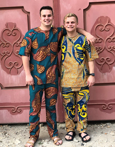 Tyler Jacobson and Chase Caverzagie wear the new outfits they successfully negotiated for at a market.