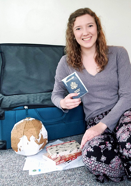 Christy Cooper's suitcase isn't packed yet, but her passport is ready.