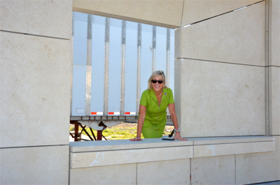 Dean Plowman surveys new building wall