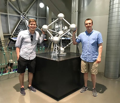 Colton and I inside the Atomium Museum with a model of the famous artifact.