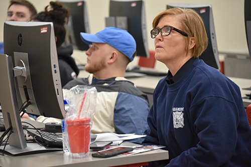 Nancy Crist, PIO for Lincoln Fire and Rescue, listens to students' presentations.