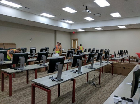 IT workers install new computers in the new classrooms.