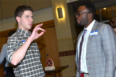 Talking to student at Meet the Professors event