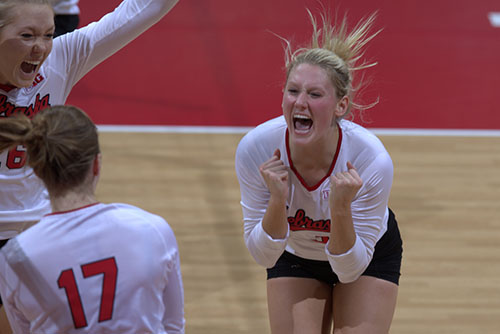 Hunter celebrates a victory over Minnesota with her teammates.