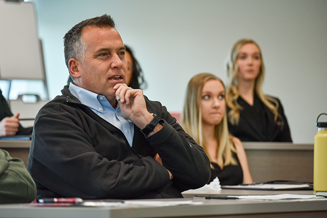 Dan Lambe, president of the Arbor Day Foundation, asked the students questions about their business pitches.