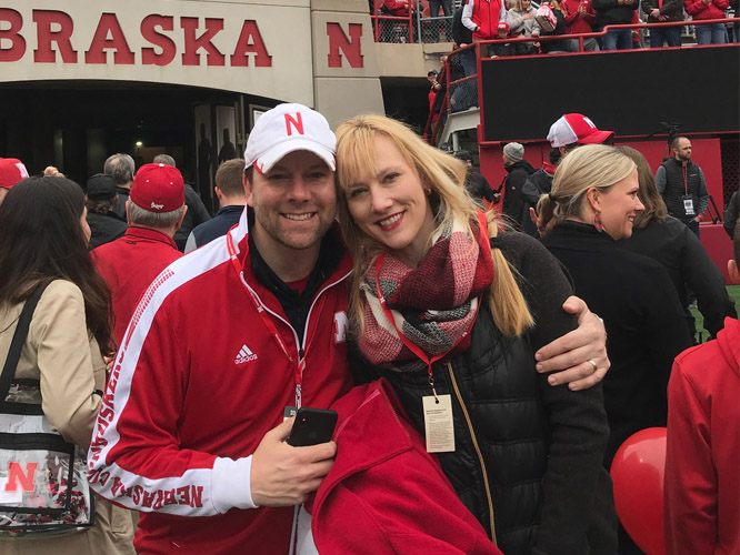 Chad Mariska and his wife, Amy, take in the sights and sounds of a Husker home football game.