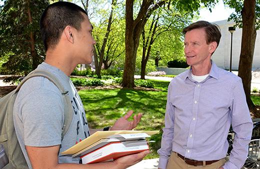 Mark Pogue (right) speaks with Clifton Builder student Phat Nguyen about his future plans on the Nebraska campus.