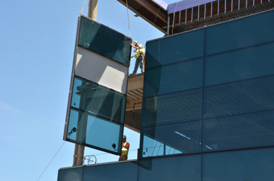 Hausmann workers hang windows at building site