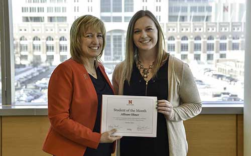 Allison Olmer receives a certificate proclaiming her the Nebraska Business Student of the Month from Dean Kathy Farrell.