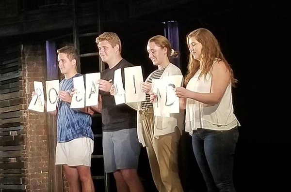 Four Nebraska students on stage.