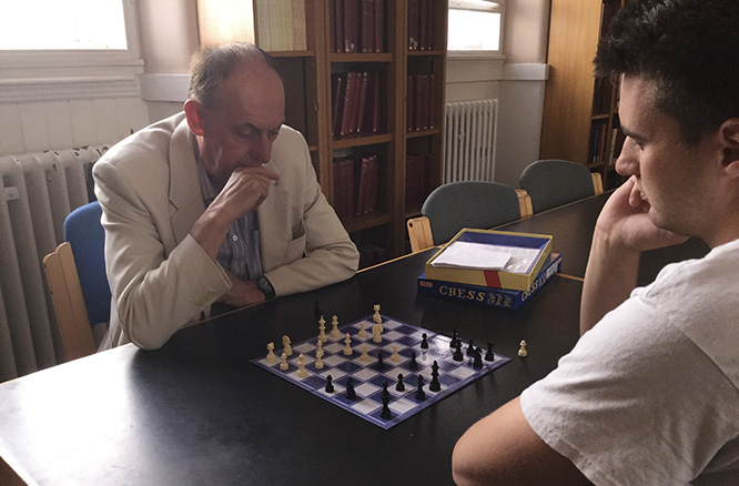Dr. Martin Holmes plays in the annual chess tournament.