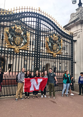 Flying the Husker colors outside Buckingham Palace.