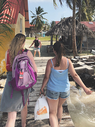 Luiza Benvenuti and Maggie walk onto one of the more than 300 San Blas Islands.