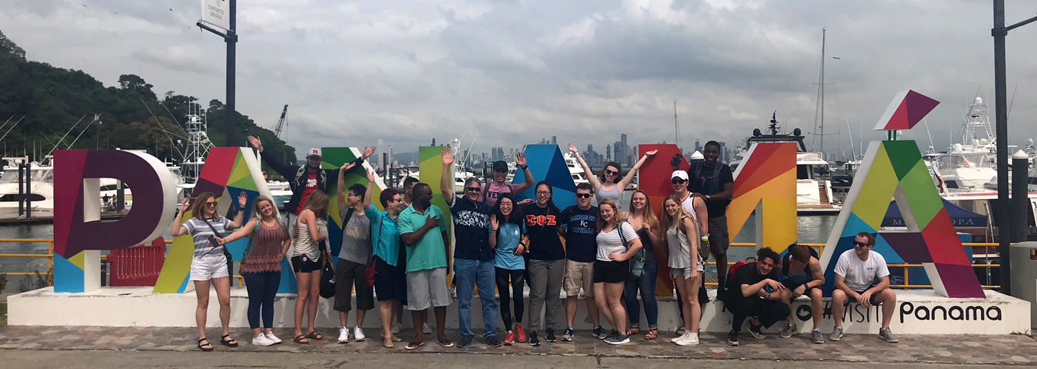 Group in front of Panama sign.