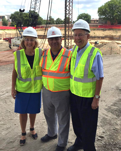 Dean Plowman, Rik Barrera and Plowman's father at construction site