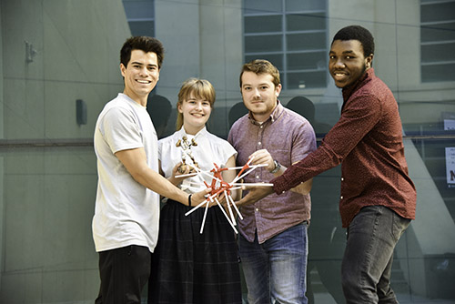 Holding their trophy and device is team Project Nitrogen (left to right): Joey Osbron, Elise Raymond, Caleb Sneed and Quincey Bernard.