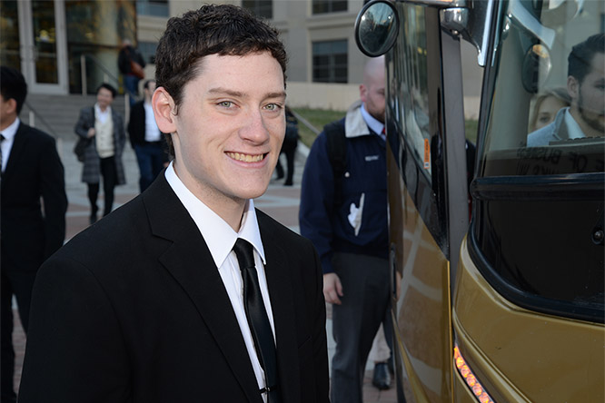 Hutchinson boards the bus with classmates headed for their final presentations in Omaha at Lincoln Financial Group.