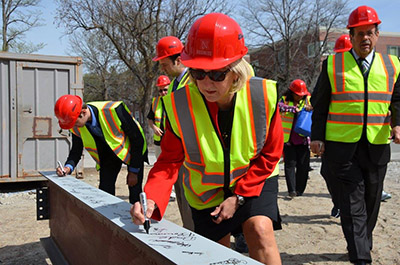 Dean Plowman adds her name to steel beam
