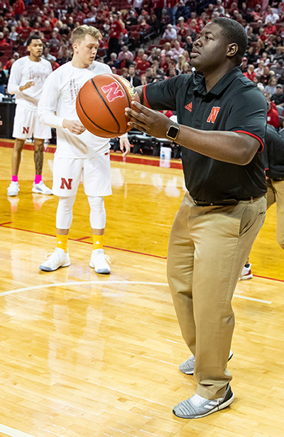 Ulysses Johnson assists the Husker