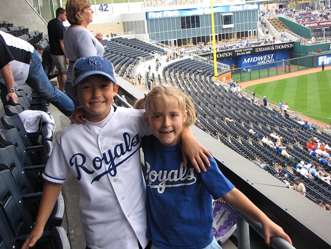Natives of Leawood, Kansas, Thomas Wolfe (left) and his sister Lucía (right), have long been avid fans of the Kansas City Royals.